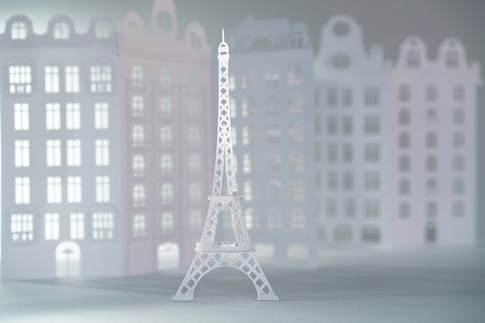 Paper cut Eiffel tower with Parisian architecture