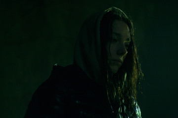 atmospheric portrait of a girl with a wet hair rain jacket