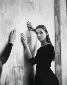 Black and White Shot of Slim Graceful Young Woman Looking at Camera