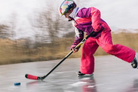 Girl Playing Hockey on Pond