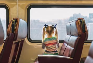 Child Riding on Train