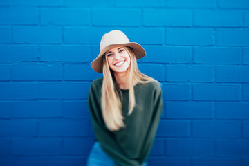 portrait of a happy woman on a blue urban background