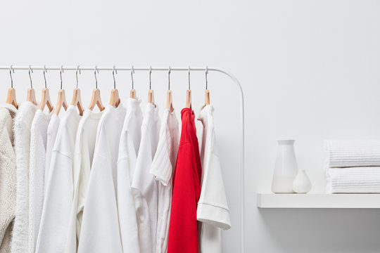 One red shirt among white clothes