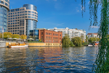 River Spree, newly designed area Spree-Bogen with buildings of the business center and hotel Villa Abion in Berlin, Germany