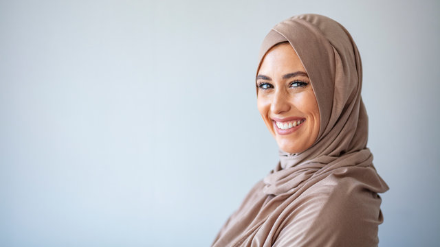 Young asian muslim woman in head scarf smile. Beautiful middle eastern woman wearing abaya. Arabian woman with happy smile. Strict formal outfit and elegant appearance. Islamic fashion.