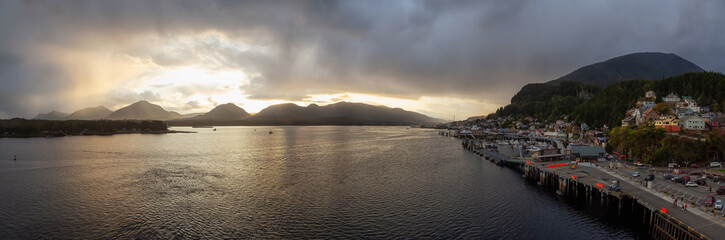 Foto op Aluminium Grijze traf. Beautiful Panoramic Aerial View of a small touristic town on the Ocean Coast during a stormy and rainy sunset. Taken in Ketchikan, Alaska, United States.