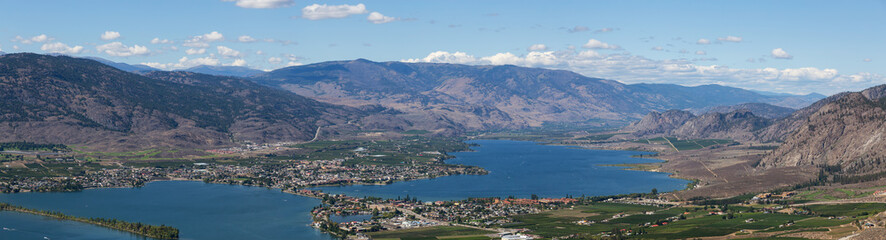 Fototapete - Aerial Panoramic View of a Small Touristic Town during a beautiful sunny summer day. Taken in Osoyoos, British Columbia, Canada.