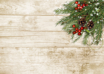 Christmas tree branch, decorations with holly on wooden board