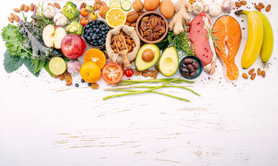 Obraz Ketogenic low carbs diet concept. Ingredients for healthy foods selection on white wooden background. Balanced healthy ingredients of unsaturated fats for the heart and blood vessels. - fototapety do salonu