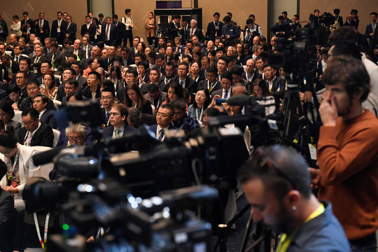 Attendees listen to a speech at the Brazil-China Business Seminar in Beijing on October 25, 2019.