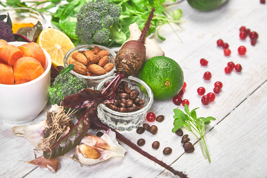 Assortment of foods for healthy liver on white wooden background. Detox nutrition after alcohol and over eating. Liver detox diet. Copy space, top view, flat  lay.