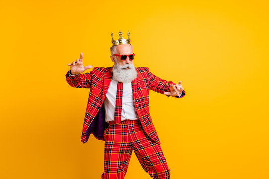 Photo of cool modern look grandpa white beard dancing king hip-hop strange moves wear crown sun specs plaid red blazer tie trousers outfit isolated yellow color background