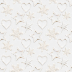 Seamless pattern with decorative stars, snowflakes, hearts. Christmas decorations on white background. New Year concept, photo pattern.