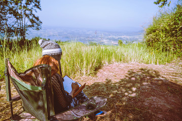 Travel relax in the holiday camping on the Mountain. Young woman tourists camping relax On the...