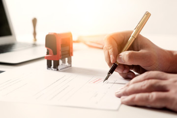 Lawyer working in office. Notary signs document