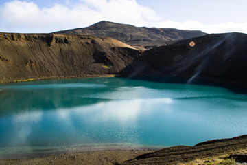 View of Krafla volcano crater with water, tourist popular attraction in Lake Myvatn, Iceland
