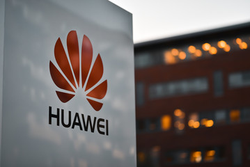 Copenhagen / Denmark - 07.23.19: Signboard of Huawei corporation on factory background in night