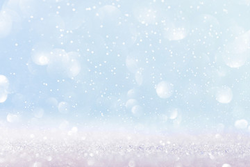 Snow and lights on blue background. Christmas abstract card.