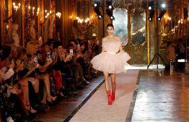 U.S. model Kendall Jenner walks on catwalk wearing a pink tulle dress during fashion show to present creations of designer Giambattista Valli and fast-fashion giant H&M