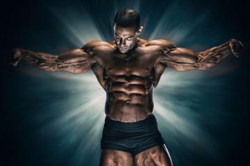 Handsome Muscular Bodybuilder Flexing Muscles