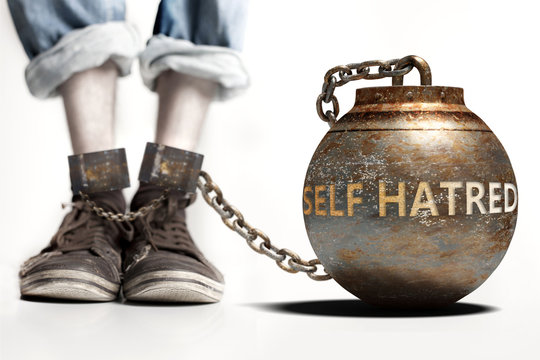 Self hatred can be a big weight and a burden with negative influence - Self hatred role and impact symbolized by a heavy prisoner's weight attached to a person, 3d illustration