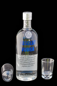 Bottle of Absolut vodka and empty shot glass, Sweden
