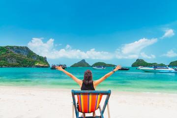 Happy woman traveler relaxing on beach chair joy fun beautiful nature scenic Angthong island beach, Leisure lifestyle tourist travel Samui Thailand summer holidays vacation, Tourism destinations Asia