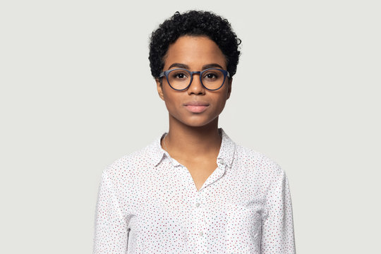 Head shot portrait beautiful young African American woman in glasses