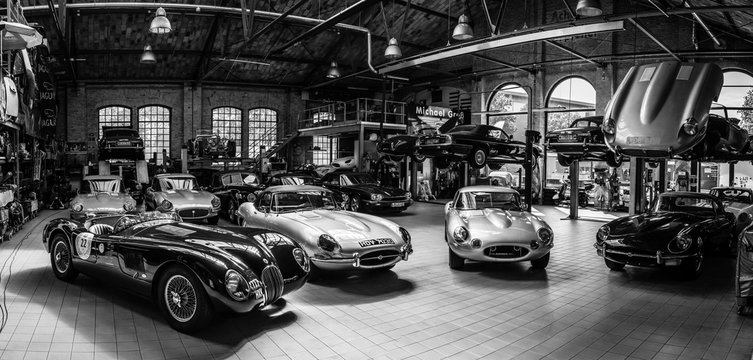 Panoramic view of the workshop for the repair and maintenance of English classic retro cars on May 01, 2019 in Berlin, Germany. Black and white.