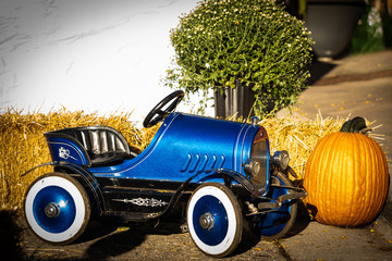Old blue rustic vintage toy car activity at a local fall fair