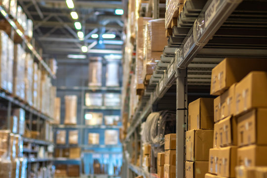 Modern warehouse with goods on shelves / focus with shallow depth of field