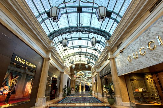 Las Vegas, Nevada, USA - May 6, 2019: Upscale shops at the Bellagio Casino and resort in Las Vegas. The luxury boutique style shops at the Bellagio include Gucci, Prada, Chanel and Louis Vuitton