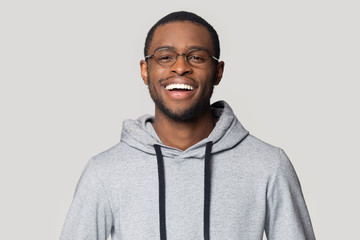 Head shot portrait laughing African American man in glasses Wall mural