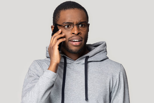 Head shot shocked African American man talking on phone