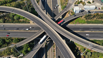 Aerial drone top down photo of urban multilevel highway junction with light traffic