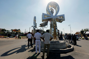 "Members of the police and Luxor's officials remove and transfer a stainless model of ""Ankh"", the Egyptian symbol known as ""Key of life"" or the ""Cross of life"" in front of Luxor Temple in Luxor"