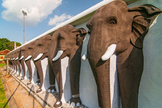 An endless line of carved elephants protect the Ruwanwelisaya Stupa in the sacred city of Anuradhapura in Sri Lanka.