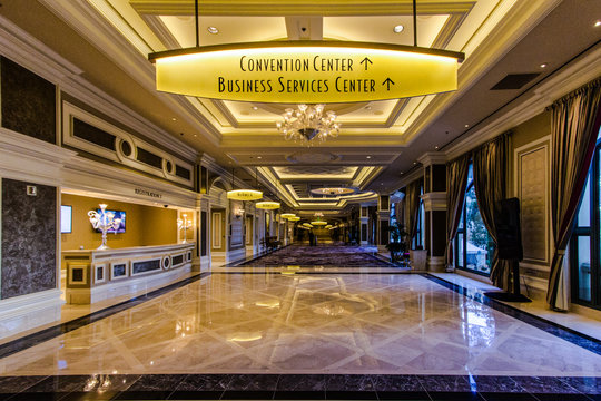 Las Vegas, Nevada, USA - May 6, 2019: Interior of the Bellagio Hotel with sign for the convention and business center. Renowned for gambling, Las Vegas is also home to massive convention centers