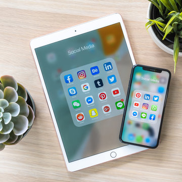 BANGKOK, THAILAND- June 26, 2019: Social media app, mobile multi-channel, cross-channel internet online application for people digital lifestyle with logo on iPhone X and ipad pro touchscreen