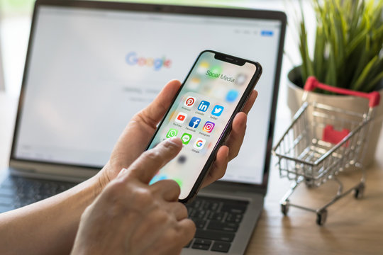 BANGKOK, THAILAND- November 19, 2018: Social media app multi-channel icons on iphone X touchscreen mobile computer cross-channel internet application technology shopping lifestyle in digital 4.0 age