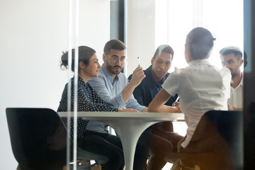 Concentrated diverse young team working process in office