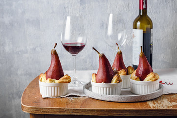 Poached pears in red wine.