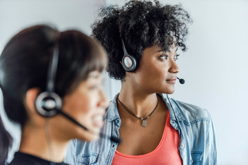 Close-up of young businesswomen wearing headset