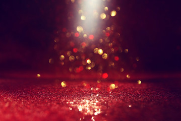 background of abstract red, gold and black glitter lights. defocused