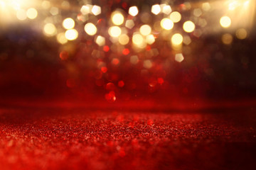 Fototapete - background of abstract red, gold and black glitter lights. defocused