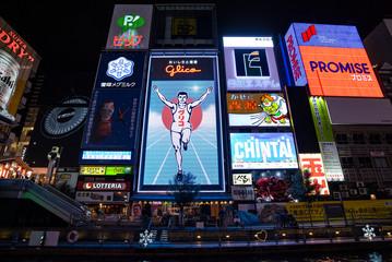 OSAKA - JAN 09: The Glico Man advertising billboard at  Dotonbori entertainment district in Osaka on January 09. 2017 in Japan. Dotonbori is one of the principal tourist destinations in Osaka.