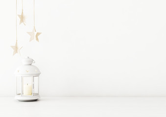 Christmas interior wall mockup with candle lantern and star garland on empty white background. 3D rendering, illustration.