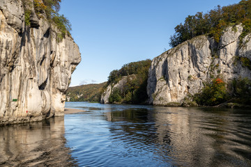 Danube river breakthrough near Kelheim, Bavaria, Germany in autumn with limestone rock formations and clear water on a sunny day at autumn month october