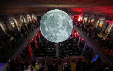 A giant ball decorated with images of the moon's surface is seen inside St. Anne's Lutheran Church in Saint Petersburg