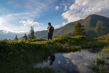 Austria, Tyrol, hiker in mountains looking at view